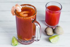 Michelada beer with tomato juice, shrimps, and lemon, mexican drink cocktail in mexico. Michelada beer with tomato juice, and lemon, mexican drink cocktail in stock image
