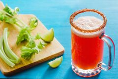 Michelada beer with tomato juice, spicy sauce and lemon, mexican drink cocktail in mexico. Michelada is beer with tomato juice, spicy sauce and lemon, mexican royalty free stock image