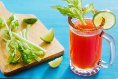 Michelada beer with tomato juice, spicy sauce and lemon, mexican drink cocktail in mexico. Cerveza stock photography