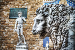 Michelangelo's David with a lion head in the foreground Stock Photography