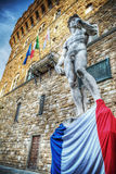 Michelangelo's David with mourning band and France flag Stock Images