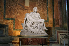 Michelangelo's La Pietà. La Pietà (The Pity), statue made by Michelangelo, inside Saint Peter Basilica, Vatican City, Rome, Italy. Note: The file Stock Image
