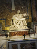Michelangelo`s Pieta in the Papal Basilica of St. Peter in Vatican City. Designed principally by Donato Bramante, Michelangelo, Carlo Maderno and Gian Lorenzo Stock Photos