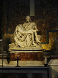 Michelangelo`s Pieta in the Papal Basilica of St. Peter in Vatican City. Designed principally by Donato Bramante, Michelangelo, Carlo Maderno and Gian Lorenzo Stock Photo