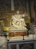 Michelangelo`s Pieta in the Papal Basilica of St. Peter in Vatican City. Designed principally by Donato Bramante, Michelangelo, Carlo Maderno and Gian Lorenzo royalty free stock photos