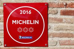 Michelin restaurant 3 stars symbol on a wall. Vonnas, France - February 23, 2017: Michelin restaurant 3 stars symbol on a wall. Michelin guides are a series of Stock Photos