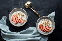 Fruit and granola yogurt bowls stock photos