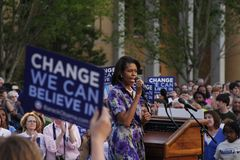 Michelle Obama. ASHEVILLE, NC - May. 2: Michelle Obama, the wife of presidential candidate Barack Obama speaking at a podium during a campaign rally at the Stock Image