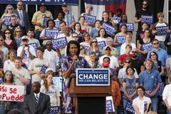 Michelle Obama. ASHEVILLE, NC - May. 2: Michelle Obama, the wife of presidential candidate Barack Obama speaking at a podium during a campaign rally at the stock photography