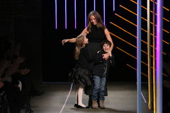 Michelle Smith bows with her children at the Milly By Michelle Smith Show during MBFW Fall Stock Photos