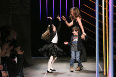 Michelle Smith bows with her children at the Milly By Michelle Smith Show during MBFW Fall 2015 Stock Photo
