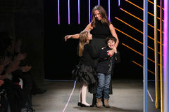 Michelle Smith bows with her children at the Milly By Michelle Smith Show during MBFW Fall 2015 Royalty Free Stock Photography