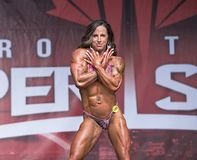Curvy, Muscled Female Physique Athlete Poses at 2018 Toronto Pro Supershow Stock Images