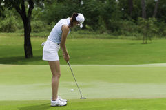 Michelle Wie putts golf ball to hole Royalty Free Stock Photo