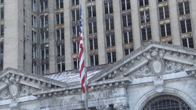 Michigan Central Station Detroit 2. Flag at the abandoned Michigan Central Station in Detroit, Michigan on a winter afternoon stock video footage