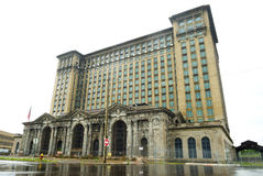 Michigan Central Station in Detroit, USA. Michigan, USA - July 30, 2017: A view of the abandoned Michigan Central Station reflected in the rain-washed streets of royalty free stock photo