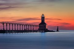 Michigan City East Pierhead Lighthouse After Sunset. Long exposure shot of Michigan City East Pierhead Lighthouse after sunset with colorful sky and dramatic stock images