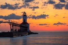 Michigan City East Pierhead Lighthouse After Sunset. Long exposure shot of Michigan City East Pierhead Lighthouse after sunset with colorful sky and dramatic royalty free stock images