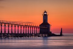 Michigan City East Pierhead Lighthouse After Sunset. Long exposure shot of Michigan City East Pierhead Lighthouse after sunset with colorful sky and dramatic royalty free stock photo