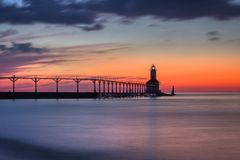 Michigan City East Pierhead Lighthouse After Sunset. Long exposure shot of Michigan City East Pierhead Lighthouse after sunset with colorful sky and dramatic royalty free stock photography