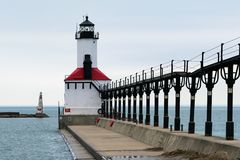 Michigan City, Indiana / USA 3/14/2018: Lightouse in calm water on an overcast day during the winter royalty free stock photo