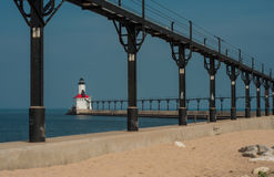 Michigan City Lighthouse. The lighthouse in Michigan City, Indiana forms a picturesque viewpoint at the end of a pier protecting its harbor stock images