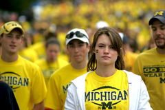 Michigan Football Fans. Michigan Wolverine footballs fan walk away from a game during a disappointing 2008 season Stock Image