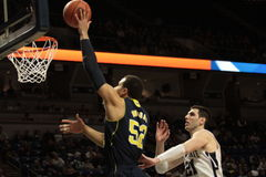 Michigan forward Jordan Morgan dunks the basketball Royalty Free Stock Photography