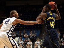 Michigan guard Tim Hardaway Jr. is guarded by Penn State's D.J. Newbill Royalty Free Stock Photo