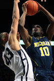 Michigan guard Tim Hardaway Jr. is guarded by Penn State's D.J. Newbill Stock Photo