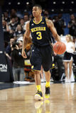 Michigan guard Trey Burke. Michigan guard Trey  Burke drives to the basket Stock Photography