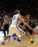 Michigan guard Trey Burke. Michigan guard Trey  Burke drives to the basket Royalty Free Stock Images