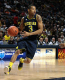 Michigan guard Trey Burke. Michigan guard Trey  Burke drives to the basket Royalty Free Stock Photos