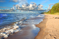 Michigan Lake Superior Beach. Waves along the beach of Lake Superior in northern Michigan under beautiful sunlight Stock Photo