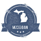 Michigan mark. Travel rubber stamp with the name and map of Michigan, vector illustration. Can be used as insignia, logotype, label, sticker or badge of USA Royalty Free Stock Image