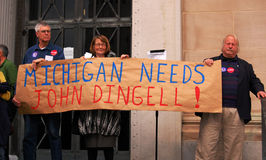 Michigan needs John Dingell sign. ANN ARBOR, MI - OCTOBER 24: Supporters holding up Michigan needs John Dingell sign prior to a get out the vote rally in Ann Stock Images