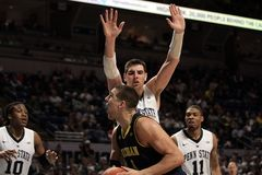 Michigan's Mitch McGary No. 4 Royalty Free Stock Photo