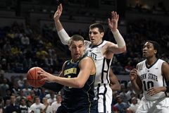 Michigan's Mitch McGary #4 tries to get a shot off Stock Photos