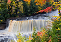 Michigan's Tahquamenon Falls in Autumn. Tahquamenon Falls in Michigan's eastern Upper Peninsula is seen with colorful fall foliage. This beautiful waterfall is Stock Photo