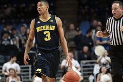 Michigan's #3 Trey Burke brings the ball up the court Royalty Free Stock Images