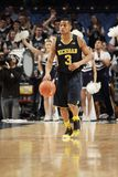 Michigan 's Trey Burke. Dribbles the ball up the court against Penn State Stock Photos