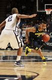 Michigan's #3 Trey Burke. Dribbles the basketball Royalty Free Stock Images