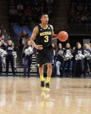 Michigan's #3 Trey Burke. Dribbles the basketball Stock Image