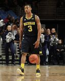 Michigan's #3 Trey Burke. Dribbles the basketball Royalty Free Stock Image