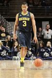 Michigan's #3 Trey Burke. Dribbles the basketball Stock Photography