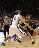 Michigan's #3 Trey Burke. Dribbles the basketball against Penn State Stock Photo