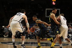 Michigan's Trey Burke. Drives as pick is set against Penn State Stock Images