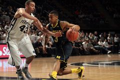Michigan's #3 Trey Burke. Drives to the basket Stock Photos