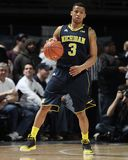 Michigan's #3 Trey Burke. Drives to the basket Royalty Free Stock Photo