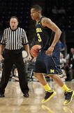 Michigan's #3 Trey Burke. Drives to the basket Royalty Free Stock Photos